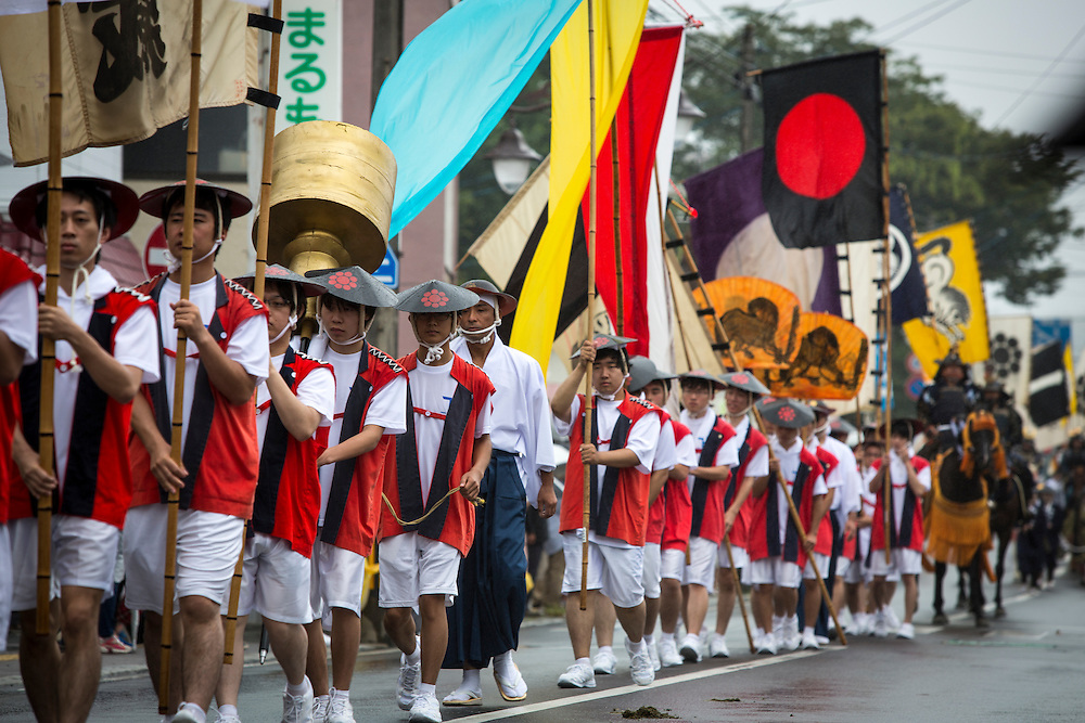 """MINAMISOMA, JAPAN - JULY 24 :  Participants is seen parade during the """"Hon Matsuri"""", Soma Nomaoi festival at Hibarigahara field on Sunday, July 24, 2016 in Minamisoma, Fukushima Prefecture, Japan. """"Soma-Nomaoi"""" is a three day traditional festival that recreates a samurai battle scene from more than 1,000 years ago. The festival has gathered more than thousands visitors as Fukushima still continues to recovery from the 2011 nuclear disaster, the samurai warriors battles for recovery of the area. (Photo: Richard Atrero de Guzman/NURPhoto)"""