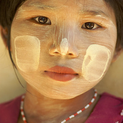 Paste from the tanaka leaves marks the face of a young Burmese girl in the Bagan region of Myanmar.