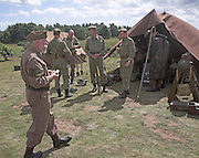 Living History event with Home Guard soldiers standing by tents at their camp.