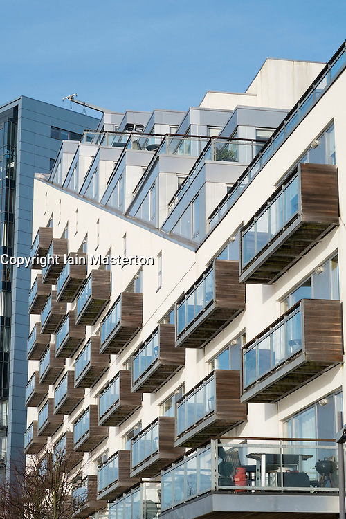 Modern high-rise apartment buildings on River Clyde at Glasgow Harbour development in Glasgow Scotland UK