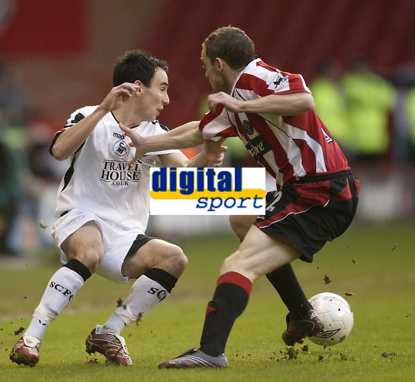 Photo: Aidan Ellis.<br /> Sheffield United v Swansea City. The FA Cup. 06/01/2007.<br /> Swansea's Leon Britton takes on Sheffield's Alan quinn