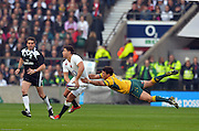 Twickenham, Great Britain,  Englands' Ben YOUNGS gets his pass away despite the flying tackle from, Nick PHIPPS, during the QBE Autumn International, England vs Australia, played at the RFU Stadium, Twickenham, ENGLAND. 14:32:30   Saturday  29/11/2014  [Mandatory Credit; Peter Spurrier/Intersport-images]