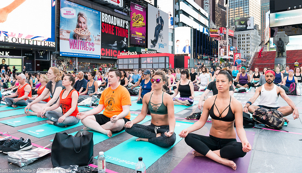 Large yoga session in Times Square in honor of the solstice, in New York City, New York on June 21, 2017.