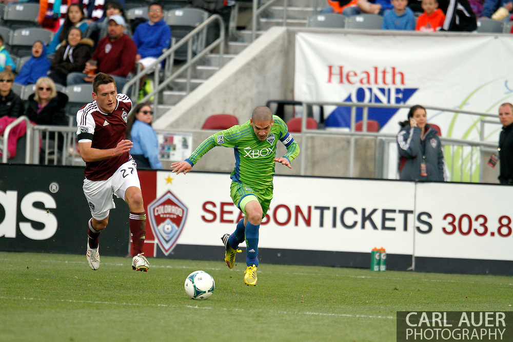 April 20th, 2013 Commerce City, CO - Seattle Sounders FC midfielder Osvaldo Alonso (6) attempts to outrun Colorado Rapids midfielder Shane O'Neill (27) to get to the ball first in the second half of the MLS match between the Seattle Sounders FC and the Colorado Rapids at Dick's Sporting Goods Park in Commerce City, CO