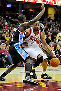 Jan. 21, 2011; Cleveland, OH, USA; Milwaukee Bucks small forward Corey Maggette (5) drives around Cleveland Cavaliers guard Christian Eyenga (8) during the first quarter at Quicken Loans Arena. Mandatory Credit: Jason Miller-US PRESSWIRE