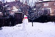 Snowman in suburban garden, Ilford, Essex, England winter of 1962