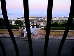 MALTA GOZO NADUR 19JUL06 - Catholic nuns stroll along the promenade at Nadur heights, enjoying the sunset and view over the Gozo Channel and the islands of Comino and Malta...jre/Photo by Jiri Rezac..© Jiri Rezac 2006..Contact: +44 (0) 7050 110 417.Mobile:  +44 (0) 7801 337 683.Office:  +44 (0) 20 8968 9635..Email:   jiri@jirirezac.com.Web:    www.jirirezac.com