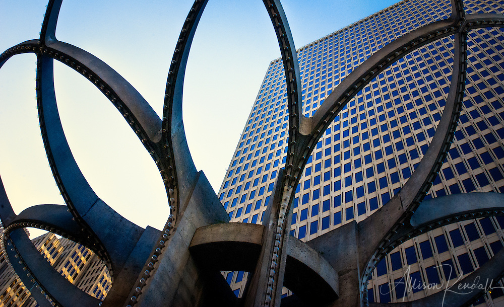 Financial district skyscrapers and office buildings framed by a geometric sculpture in downtown San Francisco