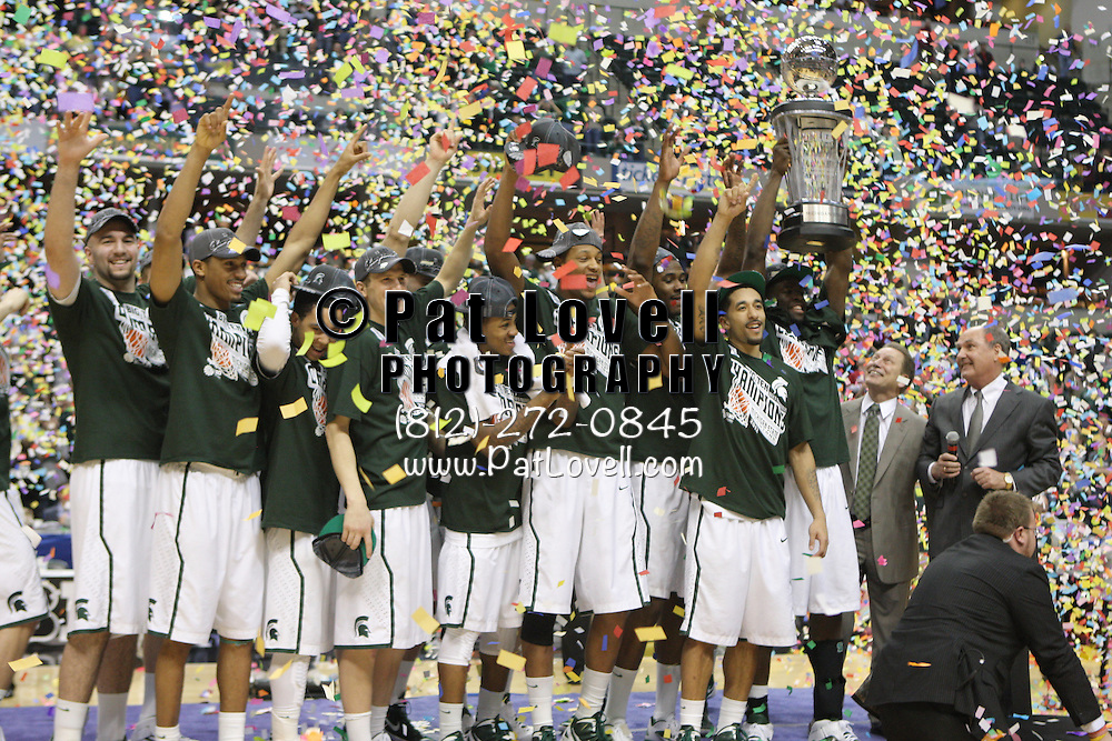March 11, 2012:  2012 Big Ten Champions Michigan State Spartans and head coach Tom Izzo pose for a photo with the trophy during the championship game between Michigan State and Ohio State at the 2012 Big Ten Tournament held at Bankers Life Fieldhouse in Indianapolis, Indiana. Michigan State beat Ohio State 68-64.