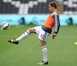 Swansea City's Angel Rangel Warms up prior to making his 100th Premier League appearance. - Photo mandatory by-line: Alex James/JMP - Mobile: 07966 386802 30/08/2014 - SPORT - FOOTBALL - Swansea - Liberty Stadium - Swansea City v West Brom - Barclays Premier League