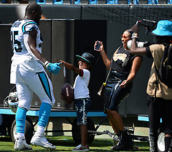 September 17, 2017 - Charlotte, NC, USA - Carolina Panthers defensive end Charles Johnson, left, jokes with his son, Prince, and girlfriend, Ebony Johnson, prior to the team's game against the Buffalo Bills on Sunday, Sept. 17, 2017 at Bank of America Stadium in Charlotte, N.C. The Panthers defeated the Bills 9-3. (Credit Image: © Jeff Siner/TNS via ZUMA Wire)
