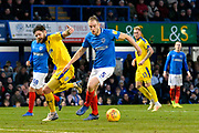 Matt Clarke (5) of Portsmouth gets the ball off Anthony Wordsworth (40) of AFC Wimbledon during the EFL Sky Bet League 1 match between Portsmouth and AFC Wimbledon at Fratton Park, Portsmouth, England on 1 January 2019.