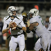 South Florida Bulls quarterback Mike White (14) drops back for a pass during an NCAA football game between the South Florida Bulls and the 17th ranked University of Central Florida Knights at Bright House Networks Stadium on Friday, November 29, 2013 in Orlando, Florida. (AP Photo/Alex Menendez)