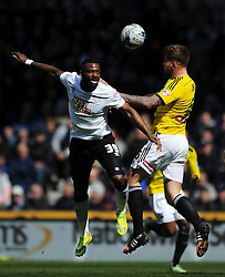 Brentford Dean Harlee holds of Derby Darren Bent, Derby County v Brentford, Sy Bet Championship, IPro Stadium, Saturday 11th April 2015. Score 1-1,  (Bent 92) (Pritchard 28)<br /> Att 30,050