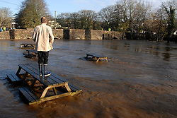 ©London News pictures... 17/11/2010. A man watches the rising flood water. The River Fowey burst its banks at Lost Withiel in Cornwall. today (Wednesday). Some people have been left trapped in their cars and homes in parts of Cornwall as heavy rain and gale-force winds caused flooding and disruption.