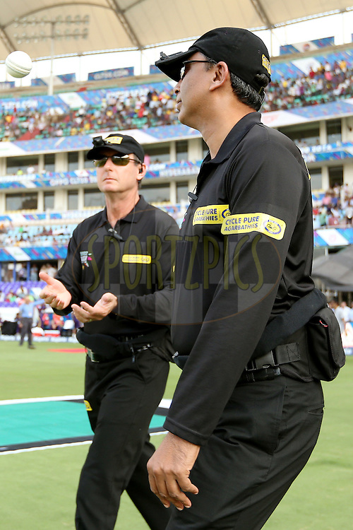Standing umpires S Ravi and Ron Tacker walking out onto the field during the first semi final match of the Oppo Champions League Twenty20 between the Kolkata Knight Riders and the Hobart Hurricanes held at the Rajiv Gandhi Cricket Stadium, Hyderabad, India on the 2nd October 2014. Photo by:  Jacques Rossouw / Sportzpics/ CLT20<br /> <br /> <br /> Image use is subject to the terms and conditions as laid out by the BCCI/ CLT20.  The terms and conditions can be downloaded here:<br /> <br /> http://sportzpics.photoshelter.com/gallery/CLT20-Image-Terms-and-Conditions-2014/G0000IfNJn535VPU/C0000QhhKadWcjYs