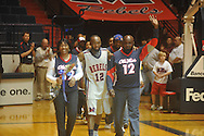 "Ole Miss guard Chris Warren (12)  with his family and Ole Miss head coach Andy Kennedy against Arkansas on Senior Day at C.M. ""Tad"" Smith in Oxford, Miss. on Saturday, March 5, 2010. Ole Miss won 84-74."