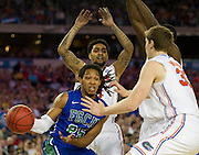 Sherwood Brown (25) of the Florida Gulf Coast University Eagles is surrounded by the University of Florida Gators defense during the NCAA South Regionals at Cowboys Stadium in Arlington on Friday, March 29, 2013. (Cooper Neill/The Dallas Morning News)