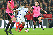 Scotland Midfielder Scott Brown tackles England Forward Raheem Sterling during the FIFA World Cup Qualifier group stage match between England and Scotland at Wembley Stadium, London, England on 11 November 2016. Photo by Phil Duncan.