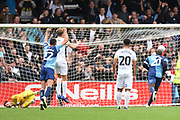Wycombe Wanderers striker Adebayo Akinfenwa (20) tends Peterborough United goalkeeper Christy Pym (1) the wrong way as he scores a penalty 3-3 during the EFL Sky Bet League 1 match between Wycombe Wanderers and Peterborough United at Adams Park, High Wycombe, England on 5 October 2019.