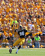 August 31 2013: Iowa Hawkeyes kicker Mike Meyer (96) kicks off during the first quarter of the NCAA football game between the Northern Illinois Huskies and the Iowa Hawkeyes at Kinnick Stadium in Iowa City, Iowa on August 31, 2013. Northern Illinois defeated Iowa 30-27.