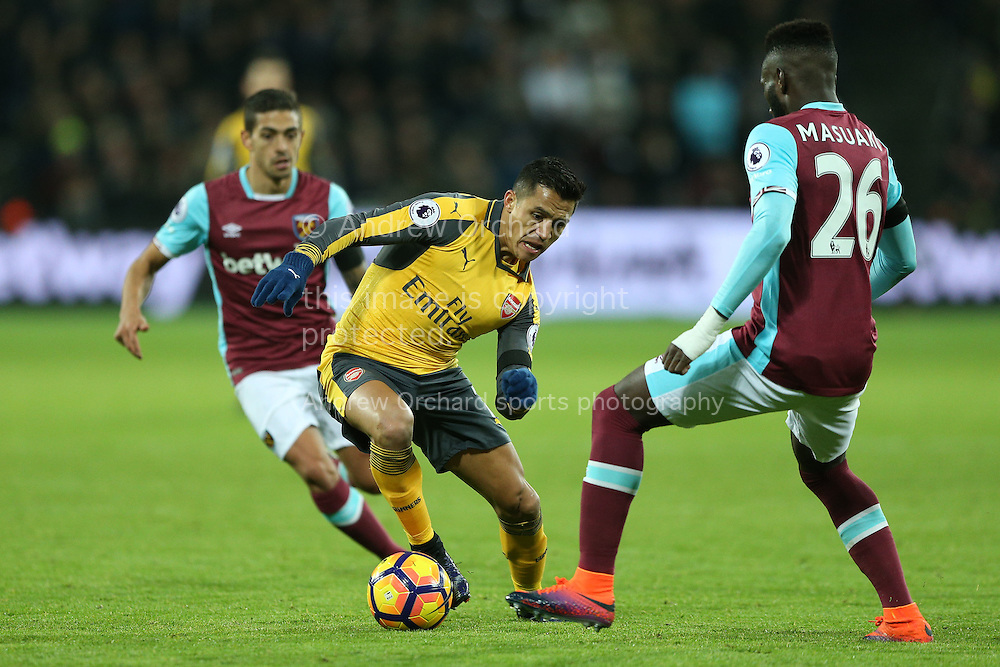 Alexis Sanchez of Arsenal &copy; looks to go past Arthur Masuaku of West Ham United. Premier league Premier league match, West Ham Utd v Arsenal at the London Stadium, Queen Elizabeth Olympic Park in London on Saturday 3rd December 2016.<br /> pic by John Patrick Fletcher, Andrew Orchard sports photography.