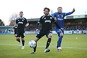 Portsmouth midfielder Adam Barton (15) and AFC Wimbledon midfielder Sean Rigg (11) during the Sky Bet League 2 match between AFC Wimbledon and Portsmouth at the Cherry Red Records Stadium, Kingston, England on 26 April 2016.