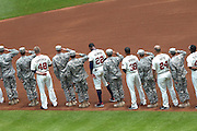 Members of the Atlanta Braves and the US Armed Forces celebrate Salute to Service Day during the game between the Arizona Diamondbacks and the Atlanta Braves at Turner Field.