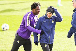 Sergio Aguero & Wilfred Bony of Manchester City share a joke during the training session at The Etihad Campus ahead of the UEFA Champions League clash with FC Barcelona - Photo mandatory by-line: Matt McNulty/JMP - Mobile: 07966 386802 - 23/02/2015 - SPORT - Football - Manchester - Etihad Stadium