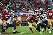 San Francisco 49ers tight end Garrett Celek (88) carries the ball against the Seattle Seahawks at Levi's Stadium in Santa Clara, Calif., on November 26, 2017. (Stan Olszewski/Special to S.F. Examiner)