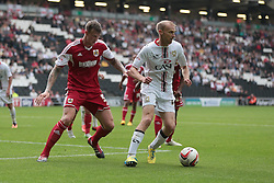 Milton Keynes Dons' Luke Chadwick is shadowed by Bristol City's Aden Flint   - Photo mandatory by-line: Nigel Pitts-Drake/JMP - Tel: Mobile: 07966 386802 24/08/2013 - SPORT - FOOTBALL - Stadium MK - Milton Keynes - Milton Keynes Dons V Bristol City - Sky Bet League One
