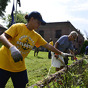 BRONX, NY - 8/18/2018 - Chief Select Hospital Corpsman<br /> Marchant Da Silva helps clean up the yard at Samuel H. Young American Legion Post 620 on Saturday. U.S. Navy Chief Selects from Navy Operational Support Center New York volunteered as part of CPO 365 Phase II.  (U.S. Navy Photo by Chief  Mass Communication Specialist Roger S. Duncan / RELEASED )