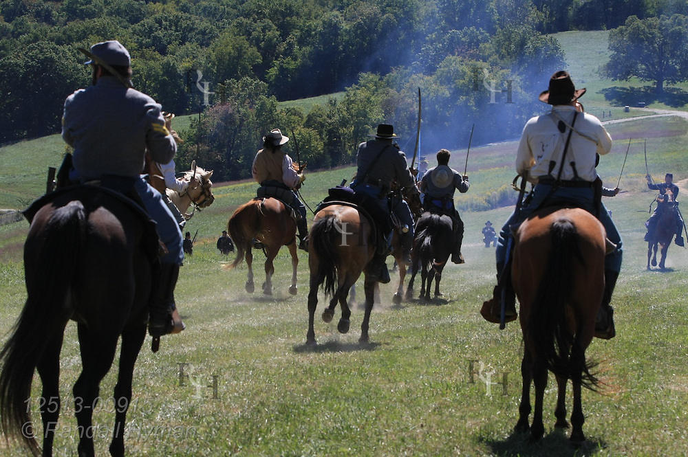Confederate cavalry rides into battle during Civil War reenactment at Hermann, Missouri.