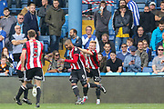 Sheffield United striker Leon Clarke (9) celebrates his goal 2-4 during the EFL Sky Bet Championship match between Sheffield Wednesday and Sheffield Utd at Hillsborough, Sheffield, England on 24 September 2017. Photo by Phil Duncan.