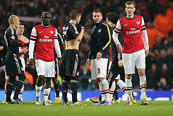 19.02.2013, Emirates Stadion, London, ENG, UEFA Champions League, FC Arsenal vs FC Bayern Muenchen, Achtelfinale Hinspiel, im Bild, vorne Per MERTESACKER (FC Arsenal London - 4) - hinten Lukas PODOLSKI (FC Arsenal London - 9) im Gespraech mit Bastian SCHWEINSTEIGER (FC Bayern Muenchen - 31) // during the UEFA Champions League last sixteen first leg match between Arsenal FC and FC Bayern Munich at the Emirates Stadium, London, Great Britain on 2013/02/19. EXPA Pictures © 2013, PhotoCredit: EXPA/ Eibner/ Gerry Schmit..***** ATTENTION - OUT OF GER *****
