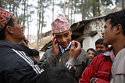 Prakash Balami, 16, is groomed by friends and family for his wedding ceremony in Kagati Village, Kathmandu Valley, Nepal on Jan. 23, 2007.  Early marriage is a harmful traditional practice common in Nepal. The Kagati village, a Newar community, is most well known for its propensity towards this practice. Many Hindu families believe blessings will come upon them if marry off their girls before their first menstruation.