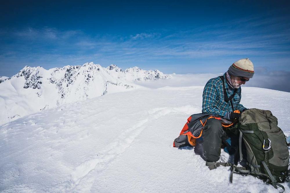 Eric Olson on the summit of Solitaire Ski Peak, Howson Range, British Columbia.
