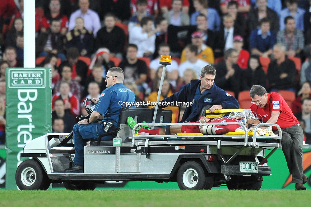 Digby Ioane is driven of the field after receiving a heavy blow to the face during action from Super 15 rugby (Round 16) - Reds v Brumbies played at Suncorp Stadium, Brisbane, Australia on Saturday 4th May 2011 ~ Photo : Steven Hight (AURA Images) / Photosport