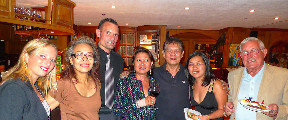 "Posing with renowned Master Water Colorist Rafael Popoy Cusi, at the Manila German Club and Transwing Kunst Gallery's presentation on the opening night of ""Filipinism"" exhibition with artists Ronna Manansala and Rigor B. Esguerra."