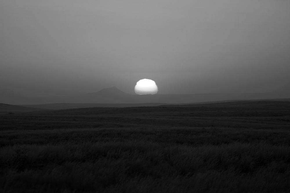 The sun goes down behind a mpuntain near Brandberg in Namibia.