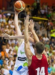 Mirza Begic of Slovenia vs Kaspars Berzins of Latvia during friendly match between National teams of Slovenia and Latvia for Eurobasket 2013 on August 2, 2013 in Arena Zlatorog, Celje, Slovenia. (Photo by Vid Ponikvar / Sportida.com)