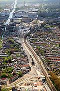 Nederland, Zuid-Holland, Delft, 09-05-2013; Spoorzone Delft, Noordelijke ingang van de spoortunnel, gezien naar het station en verder naar het zuiden. Bagijnetoren en Molen De Roos aan de Phoenixstraat staan nog overeind..Omdat het bestaande spoorviaduct met slechts twee sporen een flessenhals vorm wordt dit vervangen door een spoortunnel. Verder komt er een ondergronds station, onder het nieuwe stadskantoor..Spoorzone Delft. Because the existing railway viaduct - through the historical inner city - has only two tracks it is a bottleneck. A new underground railway tunnel is being build, it will include an underground station, under the new city hall..luchtfoto (toeslag op standard tarieven).aerial photo (additional fee required).copyright foto/photo Siebe Swart