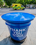 One of  a handful of Royal Mail Letter boxes painted blue as a thank you to the NHS, outside St Thomas' Hospital. The 'lockdown' continues for the Coronavirus (Covid 19) outbreak in London.