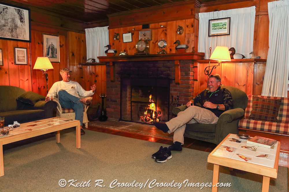Relaxing by the fire at a historic duck camp on the Delta Marsh in Manitoba, Canada