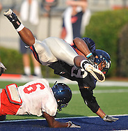 Ole Miss running back Devin Thomas (29) runs over Wesley Pendleton (6) to score during a scrimmage at Vaught-Hemingway Stadium in Oxford, Miss. on Saturday, August 20, 2011.