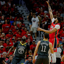 May 6, 2018; New Orleans, LA, USA; New Orleans Pelicans forward Anthony Davis (23) shoots over Golden State Warriors guard Klay Thompson (11) and forward Draymond Green (23) during the first quarter in game four of the second round of the 2018 NBA Playoffs at the Smoothie King Center. Mandatory Credit: Derick E. Hingle-USA TODAY Sports