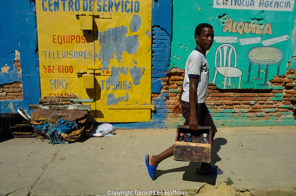 Shoe shine boy on the move in Santiago, Dominican Republic.