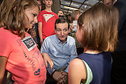 U.S. Senator Ted Cruz and GOP presidential candidate greets young girls following a town hall meeting at the famous Beacon Drive-in restaurant before April 3, 2015 in Spartanburg, South Carolina.