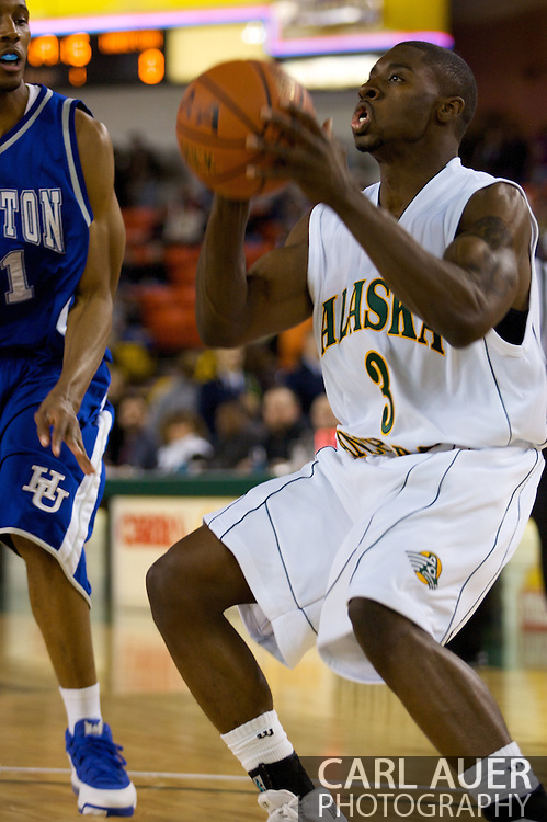 November 26, 2008: University of Alaska-Anchorage guard Lonnie Ridgeway (3) pulls up for a shot against Hampton in the opening game of the 2008 Great Alaska Shootout at the Sullivan Arena.
