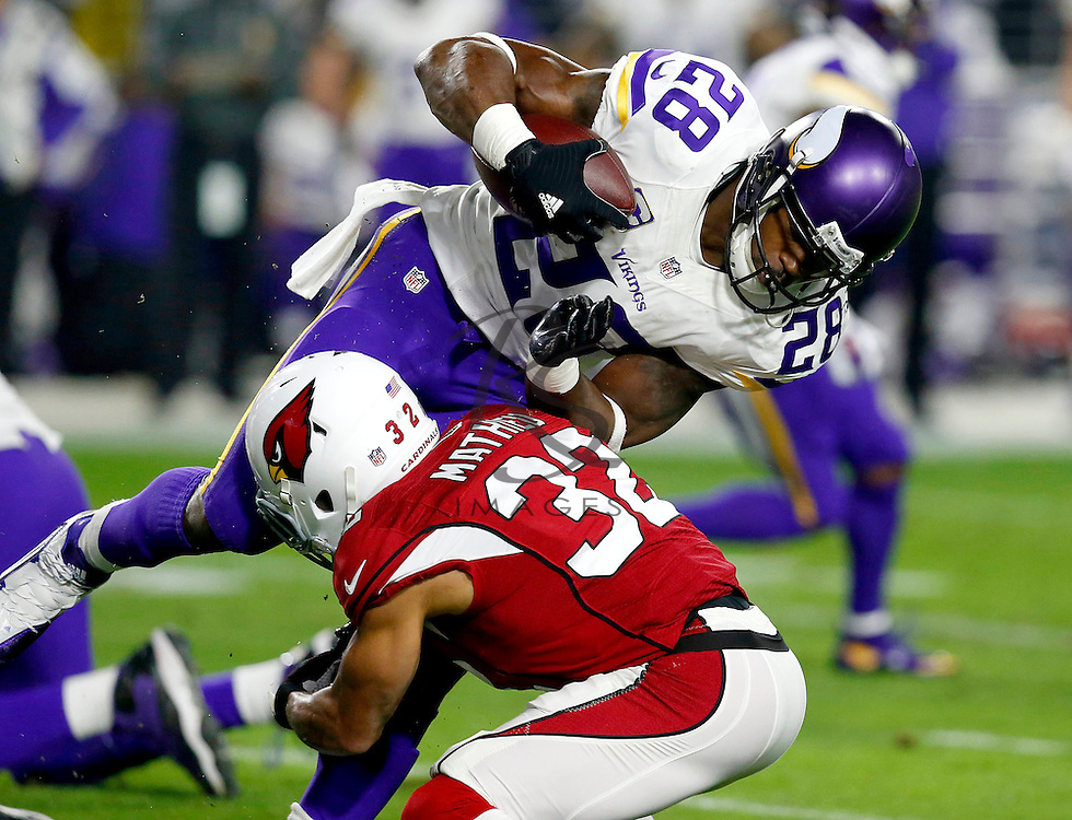 Minnesota Vikings running back Adrian Peterson (28) is hit by Arizona Cardinals free safety Tyrann Mathieu (32) during the first half of an NFL football game, Thursday, Dec. 10, 2015, in Glendale, Ariz. (AP Photo/Rick Scuteri)